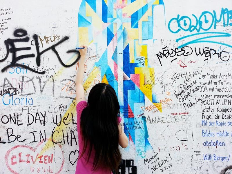 Girl doing graffiti