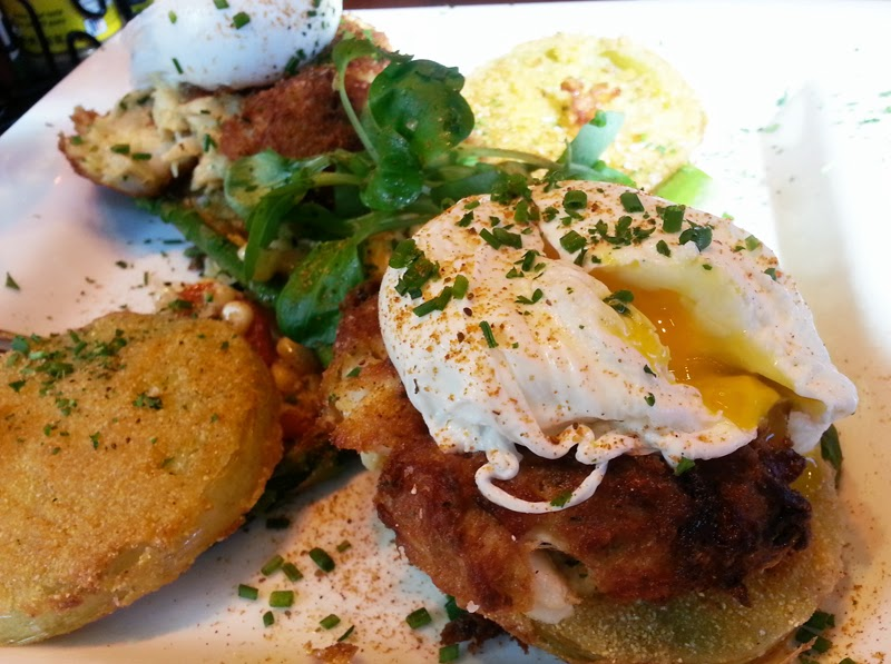 Crab eggs benedict with fried tomatoes